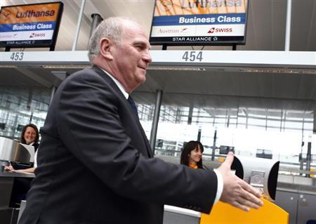 Bayern Munich's President Uli Hoeness arrives at Munich's international airport before the team's flight to Barcelona on April 30, 2013. REUTERS/Michael Dalder