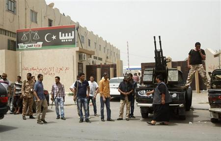 Members of armed revolutionaries stage a protest in front of the Libyan Justice Ministry in Tripoli April 30, 2013. REUTERS/Ismail Zitouny