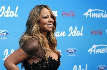 Judge Mariah Carey poses at the party for the finalists of the television show ''American Idol'' in Los Angeles, California March 7, 2013. REUTERS/Mario Anzuoni