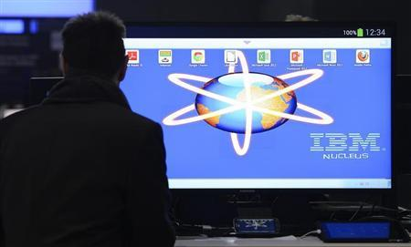 An employee installs a computer at the booth of IBM during preparations at the CeBit computer fair in Hanover, March, 4, 2013. REUTERS/Fabian Bimmer