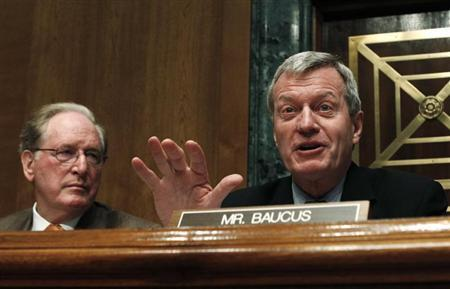 Senate Finance Committee Chairman Max Baucus speaks during a hearing on oil and gas tax incentives and rising energy prices, on Capitol Hill in Washington May 12, 2011. On left is Senator Jay Rockefeller. REUTERS/Kevin Lamarque