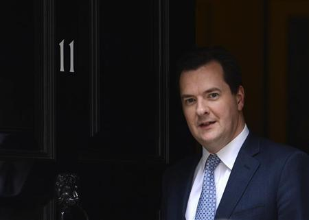 Britain's Chancellor of the Exchequer George Osborne walks out of his official residence of 11 Downing Street in London April 25, 2013. REUTERS/Paul Hackett