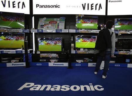 A man looks at Panasonic Corp's Viera televisions displayed at an electronics store in Tokyo March 28, 2013. REUTERS/Yuya Shino