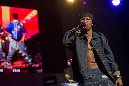 Chris Kelly of Kris Kross performs on stage at the Fox Theatre in Atlanta, Georgia during the So So Def 20th Anniversary Concert, in this photo taken February 23, 2013. REUTERS/Jonathan Phillips