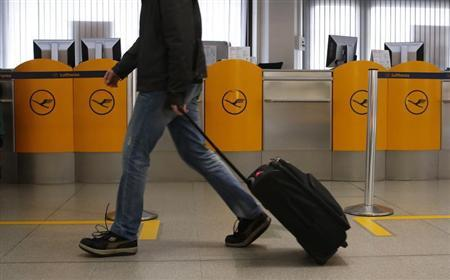 A passenger walks past an empty counter during a warning strike of German air carrier Lufthansa ground personnel at Tegel airport in Berlin, April 22, 2013. REUTERS/Fabrizio Bensch