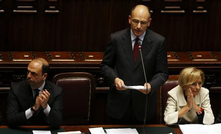 Newly appointed Italian Prime Minister Enrico Letta (C) speaks next deputy Prime Minister and Interior Minister Angelino Alfano (L) and Foreign Minister Emma Bonino at the Lower house of the parliament in Rome, April 29, 2013. REUTERS/ Alessandro Bianchi