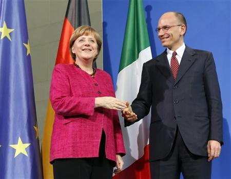 German Chancellor Angela Merkel and Italian Prime Minister Enrico Letta pose for photographers after a news conference at the Chancellery in Berlin, April 30, 2013. REUTERS/Fabrizio Bensch