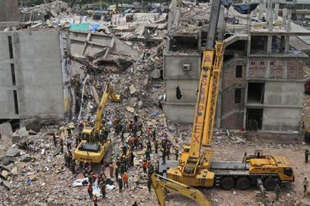 Rescue workers attempt to find survivors from the rubble of the collapsed Rana Plaza building in Savar, around 30 km (19 miles) outside Dhaka May 1, 2013. REUTERS/Stringer