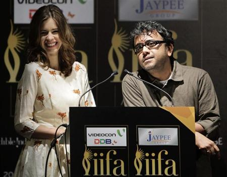 Bollywood actress Kalki Koechlin smiles as director Dibakar Banerjee (R) speaks during the opening news conference of the 13th International Indian Film Academy (IIFA) Awards in Singapore June 7, 2012. REUTERS/Tim Chong/Files