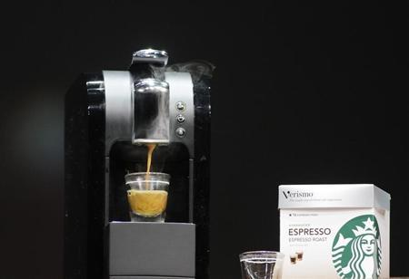 The Verismo single serve home espresso maker is demonstrated during Starbucks Annual Meeting of Shareholders in Seattle, Washington, March 21, 2012. REUTERS/Robert Sorbo