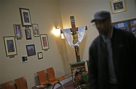 A worker walks through the reception area at Leo Catholic High School in Chicago, Illinois February 14, 2013. REUTERS/Jim Young