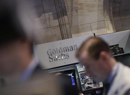 A Goldman Sachs sign is seen over the company's trading stall on the floor at the New York Stock Exchange, March 21, 2013. REUTERS/Brendan McDermid