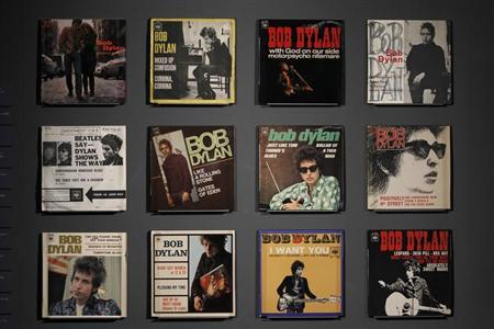 Covers of music record are displayed during the exhibition ''Bob Dylan, the rock explosion'' at the museum of the Cite de la Musique in Paris March 5, 2012. REUTERS/Charles Platiau/Files