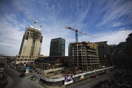 Cranes stand at various condominium developments in Toronto December 6, 2012. REUTERS/Mark Blinch