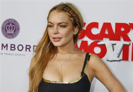 Actress Lindsay Lohan arrives at the premiere of the film ''Scary Movie 5'' in Hollywood April 11, 2013. REUTERS/Fred Prouser