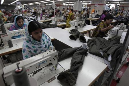 Women work at a garment factory in Savar July 27, 2012. REUTERS/Andrew Biraj/Files
