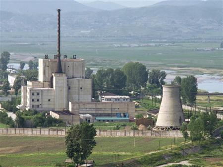 A North Korean nuclear plant is seen before demolishing a cooling tower (R) in Yongbyon, in this photo taken June 27, 2008 and released by Kyodo. REUTERS/Kyodo