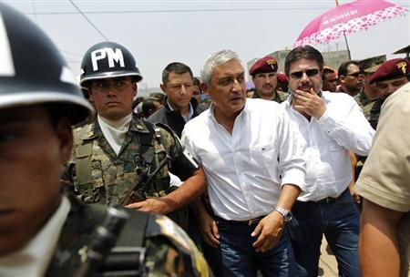 Guatemala's President Otto Perez Molina (C) arrives for the inauguration of a new military detachment in Ciudad Quetzal, on the outskirts of Guatemala City April 9, 2013. REUTERS/Jorge Dan Lopez