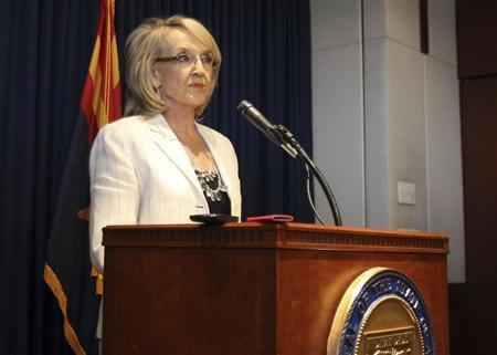 Arizona Governor Jan Brewer addresses the media about the Supreme Court's decision on SB1070 in Phoenix, Arizona, June 25, 2012. REUTERS/Darryl Webb