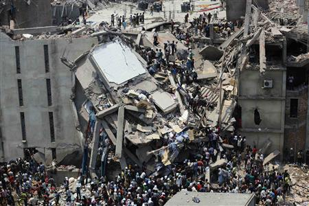 People rescue garment workers trapped under rubble at the Rana Plaza building after it collapsed, in Savar, 30 km (19 miles) outside Dhaka, in this file picture taken April 24, 2013. REUTERS/Andrew Biraj/Files