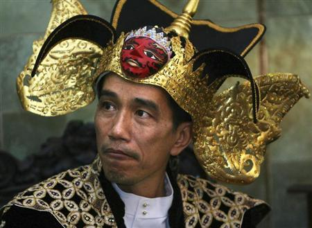 Joko Widodo, 48, a former furniture salesman who was recently elected mayor of Jakarta takes part in a Batik carnival in Solo, Central Java June 28, 2009. REUTERS/Andry Prasetyo