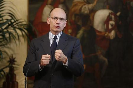 Italy's Prime Minister Enrico Letta gestures during a joint news conference with Angel Gurria, secretary-general of the Organisation for Economic Co-operation and Development (OECD) at Chigi Palace in Rome May 2, 2013. REUTERS/Tony Gentile