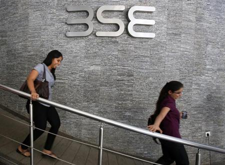Employees walk in a lobby at the Bombay Stock Exchange (BSE) during the announcement of the annual budget in Mumbai February 28, 2013. REUTERS/Vivek Prakash/Files