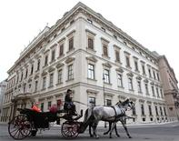 A traditional Fiaker horsecarriage passes the Stadtpalais Liechtenstein in Vienna May 2, 2013. REUTERS/Heinz-Peter Bader