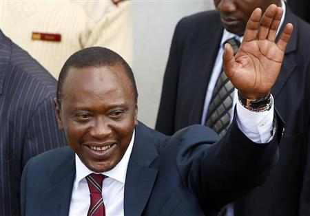 President of Kenya Uhuru Kenyatta waves to his supporters in front of a church in his hometown Gatundu March 10, 2013. REUTERS/Marko Djurica