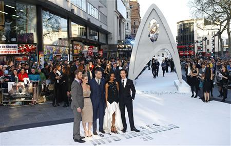 Cast members of ''Star Trek Into Darkness'' (L-R) Chris Pine, Alice Eve, Zachary Quinto, Zoe Saldana and Benedict Cumberbatch pose for photographers at the film's international premier in Leicester Square, central London, May 2, 2013. REUTERS/Andrew Winning