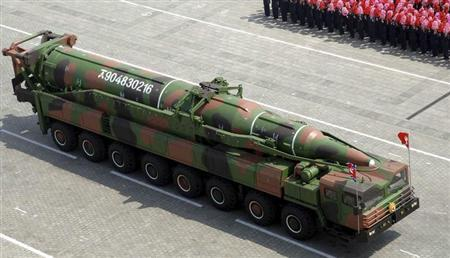 A rocket is carried by a military vehicle during a military parade to celebrate the centenary of the birth of Kim Il-sung in Pyongyang April 15, 2012 in this picture released by North Korea's KCNA on April 16, 2012. South Korea's YTN TV later cited military sources and analysts as saying the rocket is a new long-range missile, presumed to be a ballistic missile with a range of 6,000 km (3,700 miles). REUTERS/KCNA