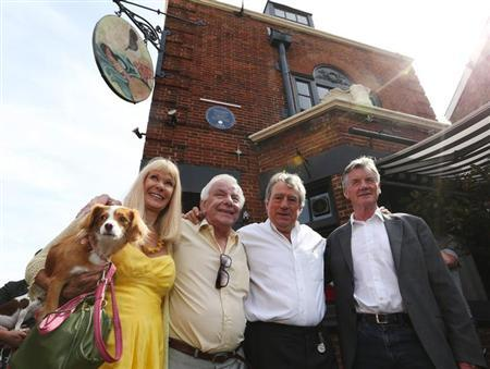 Monty Python's Flying Circus actors (L-R) Carol Cleveland, former colleague Barry Cryer, actor Terry Jones and Michael Palin pose outside the Angel pub in Highgate, north London September 6, 2012. REUTERS/Olivia Harris