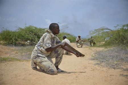 A soldier from the Somali National Army (SNA) uses a belt acting as a weapon during a training exercise in Mogadishu March 28, 2013 in this picture provided by the AU/UN Information Support Team. REUTERS/Tobin Jones/AU UN IST/Handout
