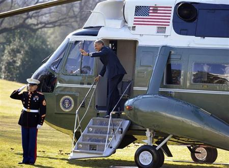 U.S. President Barack Obama waves to visitors as he steps aboard Marine One for departure from the White House, Washington February 14, 2013. REUTERS/Mike Theiler