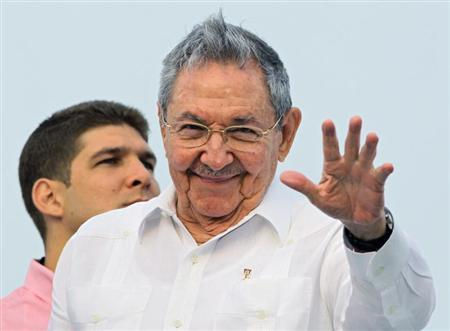 Cuba's President Raul Castro salutes at the May Day parade in Havana's Revolution Square May 1, 2013. REUTERS/Desmond Boylan \