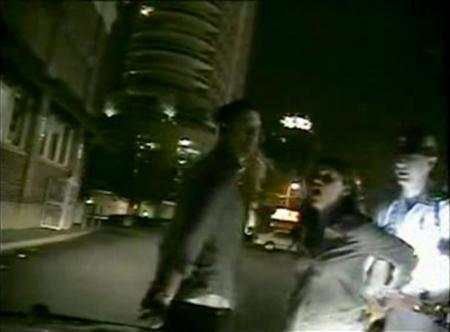 Actress Reese Witherspoon (2nd R) is pictured being arrested along with her husband Jim Toth (L) in Atlanta, Georgia in this still image from a April 19, 2013 video released by the Georgia State Patrol on May 3, 2013. Witherspoon has pleaded no contest to a charge of disorderly conduct and paid a $100 fine. Toth, 42, entered a guilty plea to drunk driving and received a $600 fine. He must also complete 40 hours of community service. REUTERS/Georgia State Patrol/Handout via Reuters