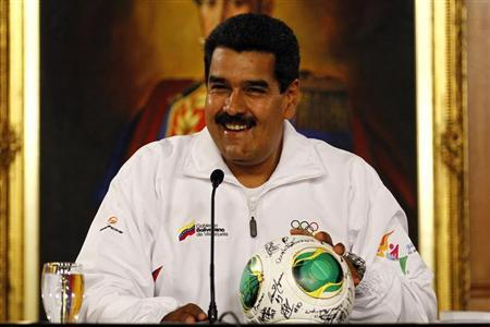 Venezuela's President Nicolas Maduro smiles during a news conference with Venezuela's Under-17 soccer team in Caracas April 30, 2013. REUTERS/Carlos Garcia Rawlins