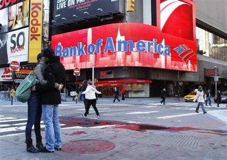 A couple embraces in front of a Bank of America sign on a building in Times Square in New York March 8, 2011. REUTERS/Lucas Jackson