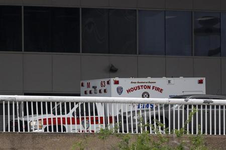 An ambulance is seen parked outside Terminal B after a gunman opened fire at the terminal in George Bush Intercontinental Airport in Houston, Texas on May 2, 2013. REUTERS/F. Carter Smith