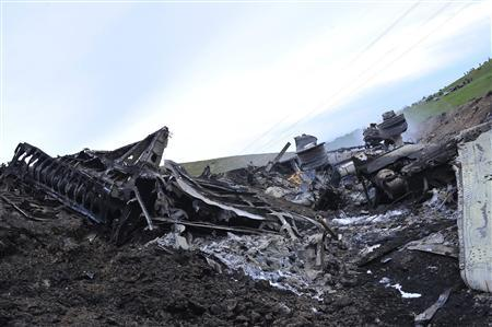 The wreckage of the Boeing KC-135 Stratotanker plane is seen at the site of its crash near the Kyrgyz village of Chaldovar, May 3, 2013. REUTERS/Sabyr Alichiev/Pool