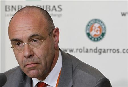 Tournament director Gilbert Ysern attends a news conference after the men's singles final match between Rafael Nadal of Spain and Novak Djokovic of Serbia was suspended for the day after rain stopped play during the French Open tennis tournament at the Roland Garros stadium in Paris June 10, 2012. REUTERS/Nir Elias