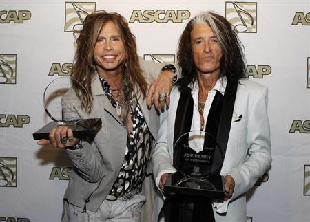 Steven Tyler (L) and Joe Perry of the group Aerosmith pose with the ASCAP Founders Award during a photo opportunity in Los Angeles April 8, 2013. REUTERS/Fred Prouser