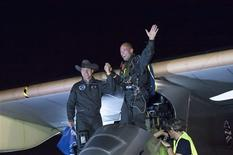 Swiss pioneers Andre Borschberg (L) and Bertrand Piccard celebrate completing the first leg of the Solar Impulse flight across the United States after arriving in Phoenix May 4, 2013. The trip is an attempt to fly across the United States with no fuel but the sun's energy. Fred Merz/Solar Impulse/Handout via REUTERS