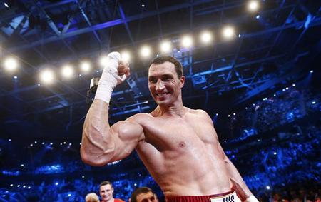 Heavyweight boxing World Champion Vladimir Klitschko of Ukraine celebrates after defeating his Italian-born challenger Francesco Pianeta at the SAP arena in Mannheim, May 4, 2013. Klitschko stopped former sparring partner Pianeta inside six rounds in Mannheim on Saturday to retain his four world heavyweight title belts. REUTERS/Kai Pfaffenbach