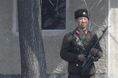 A North Korean soldier stands on the bank of Yalu River, near the North Korean town of Sinuiju, opposite the Chinese border city of Dandong, April 12, 2013. REUTERS/Jacky Chen