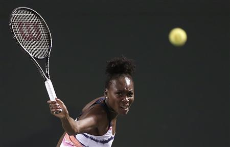 Venus Williams of the U.S. returns a shot to Kimiko Date-Krumm of Japan at the Sony Open tennis tournament in Key Biscayne, Florida March 21, 2013. REUTERS/Andrew Innerarity