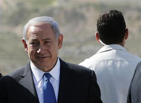 Israel's Prime Minister Benjamin Netanyahu attends an inauguration ceremony of a new highway connecting Pisgat Zeev, an urban settlement in an area Israel annexed to Jerusalem after capturing it in the 1967 Middle East war, with route 443, one of two main routes linking Israel's coastal plain with the uplands of Jerusalem, May 5, 2013. REUTERS/Ronen Zvulun