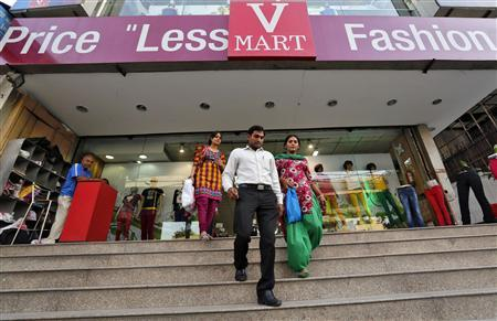 Customers exit a V-Mart retail store in New Delhi April 6, 2013. Picture taken April 6, 2013. REUTERS-Adnan Abidi