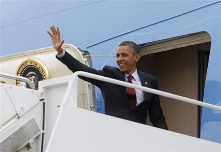 U.S. President Barack Obama waves from the Air Force One at Andrews Air Force Base near Washington, May 5, 2013. REUTERS/Jason Reed