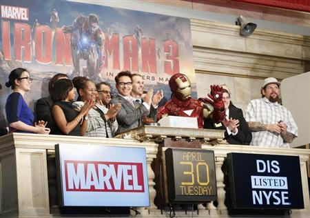 Actor Robert Downey Jr. (C) and Marvel Comics representatives ring the opening bell at the New York Stock Exchange to promote his new movie 'Iron Man 3,' April 30, 2013. REUTERS/Brendan McDermid